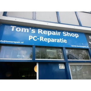 Tom's Repair Shop logo