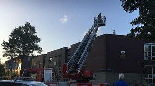 9-jarige 'Spiderman' beklimt via raamkozijnen gebouw in Amsterdam
