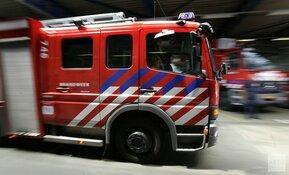 Grote uitslaande brand in woning in Amsterdam