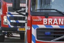 Uitslaande brand bij historische woning in binnenstad Amsterdam