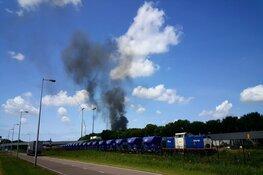 Brandend afval Amsterdam te zien in de wijde omtrek