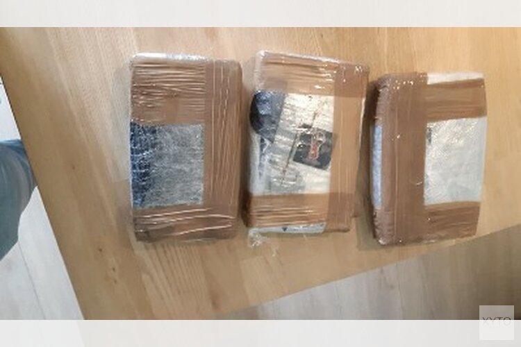 Vuurwapens, 15 kilo cocaïne en cash bij doorzoeking woning Brouwersgracht