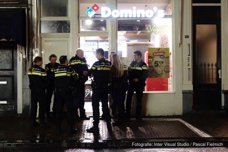 Maaltijdbezorger hardhandig beroofd van pizza's in Amsterdam