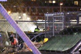 In beslag genomen auto's in lichterlaaie op politieterrein Amsterdam Slotervaart