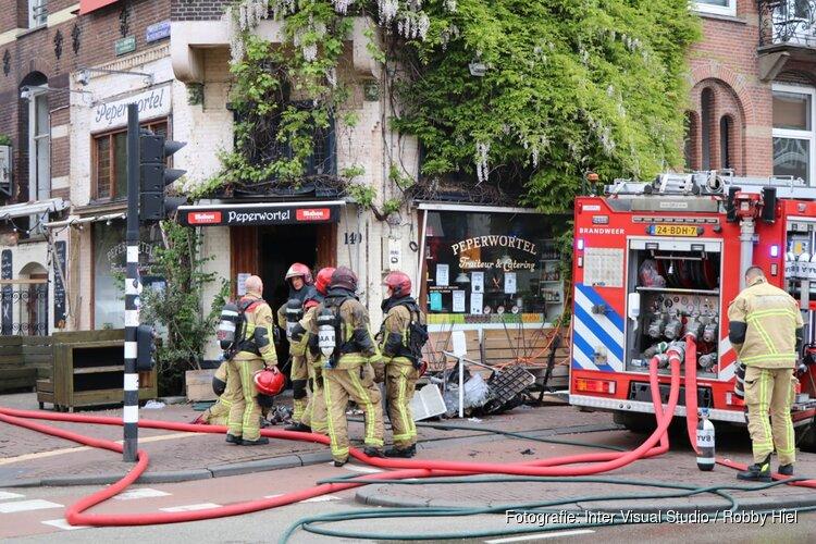 Brand in winkel, woningen ontruimd