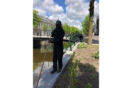 Kloveniersburgwal heeft een tuin aan de gracht