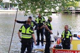 Vrouw uit water Herengracht gehaald