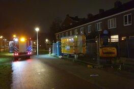 Graafmachine in brand langs de Burgemeester Roëlstraat in Amsterdam
